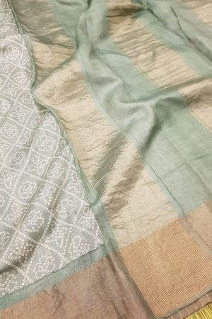 Pale green block printed tussar saree with tissue border pallu