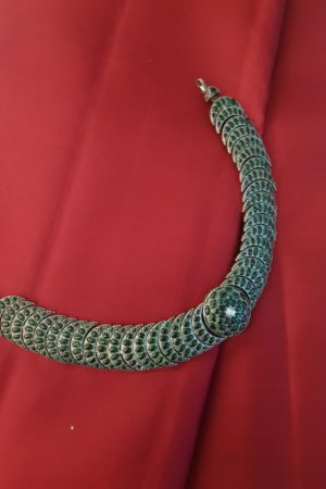Silver necklace with green stones