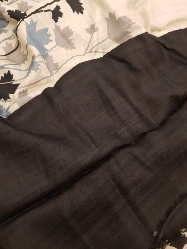 Beige tussar saree with black and grey floral border