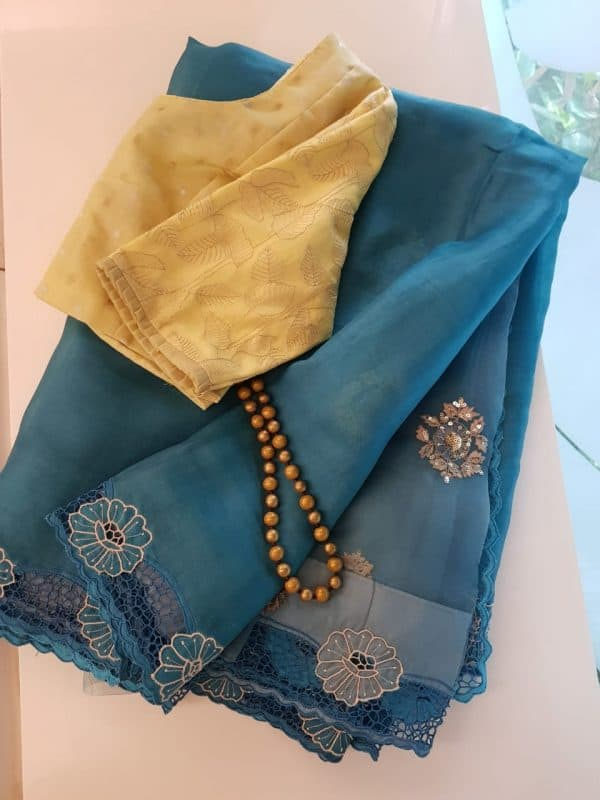 Blue organza and embroidered cutwork saree