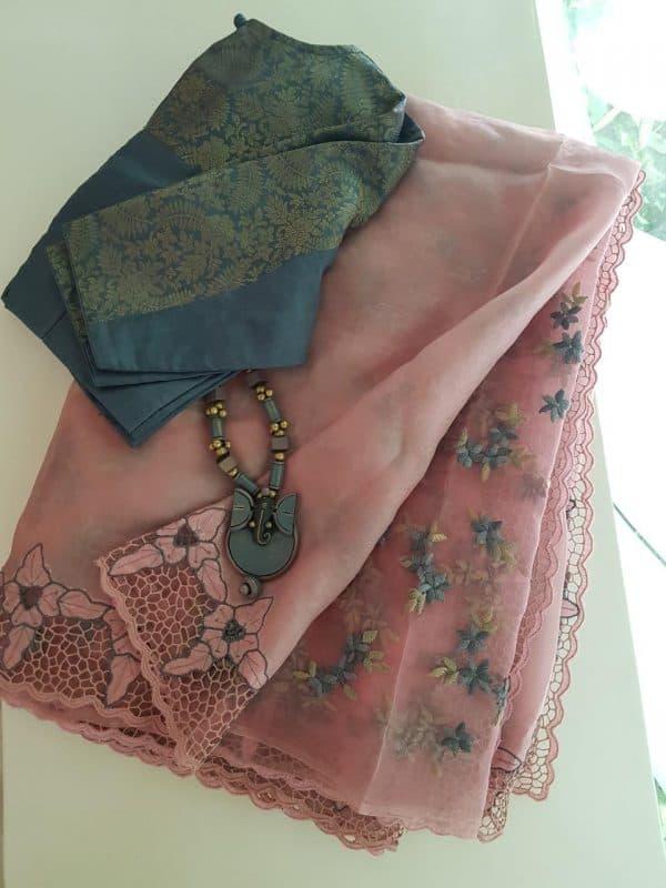 Peach organza and embroidery cutwork saree