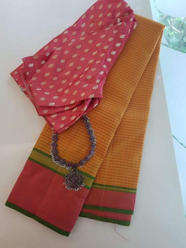 Mustard kanchipuram silk saree with peach border