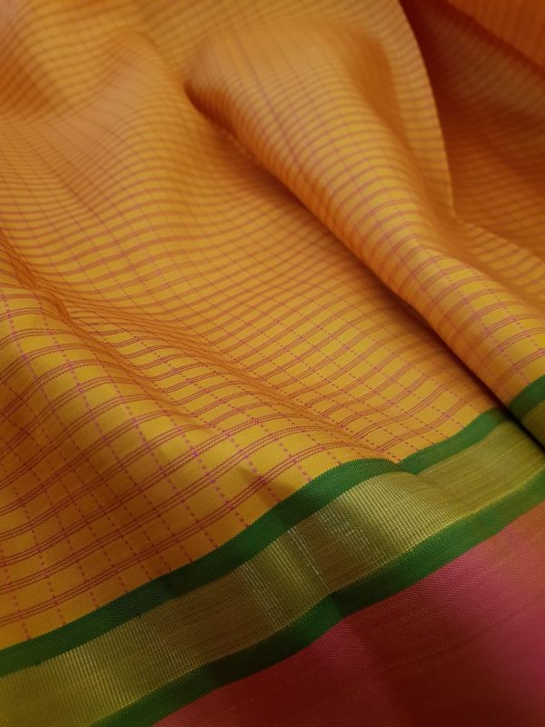 Mustard kanchipuram silk saree with peach border1