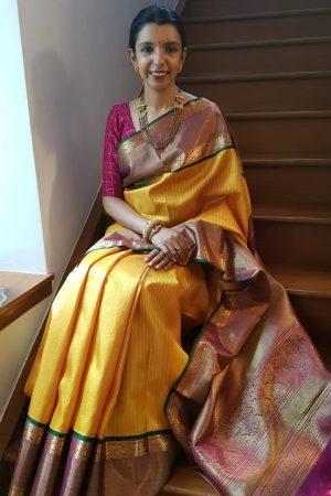 Mustard with majenta tissue korvai border kanchipuram silk saree