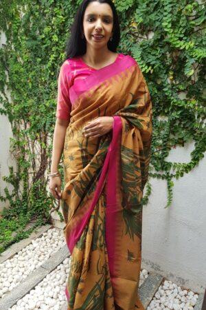Mustard with pink border khadi saree with kalamkari