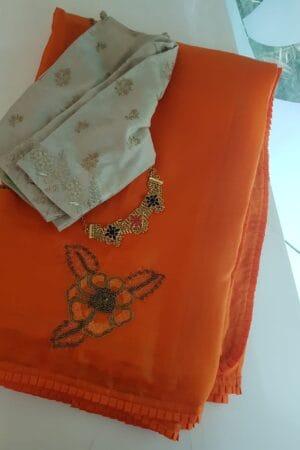 Orange organza silk hand embroidered saree