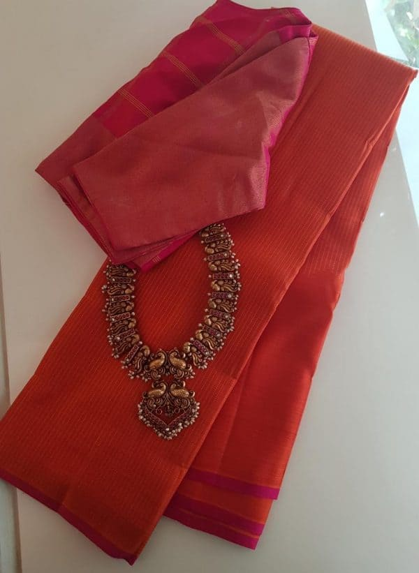 Orange rising border silk saree