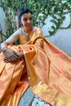 Peach kanchipuram silk saree with araimadam