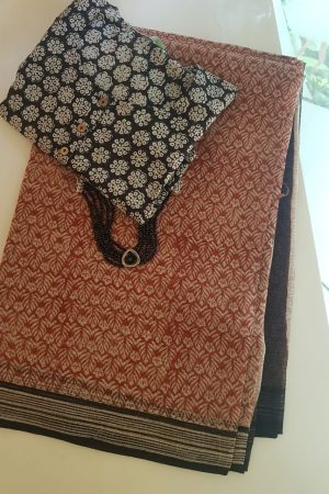 Rust, beige and black bagru printed kota doriya saree