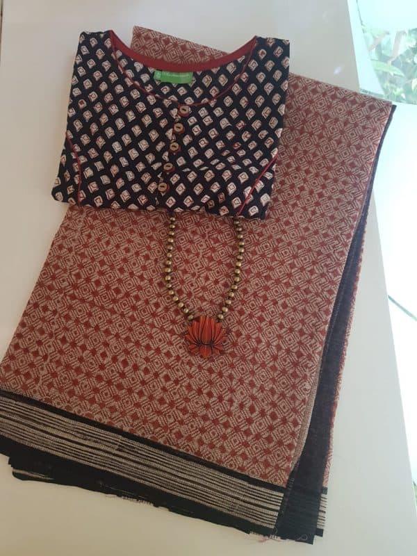 Rust, beige and black bagru printed kota saree