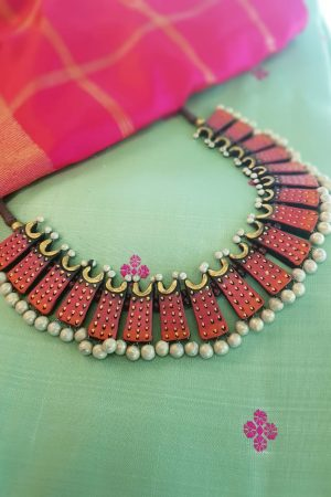 Terracotta neck piece in tomato red