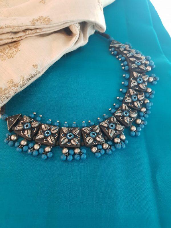 Turquoise blue neck piecein terracotta
