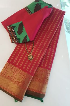 Arakku red kanchipuram silk saree with mayil chakram