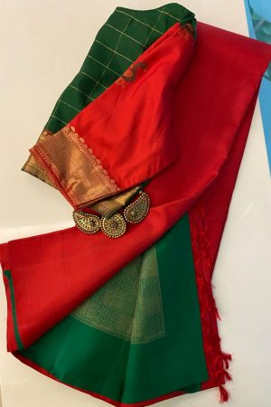 Arakku red kanchipuram silk saree with green pallu and blouse