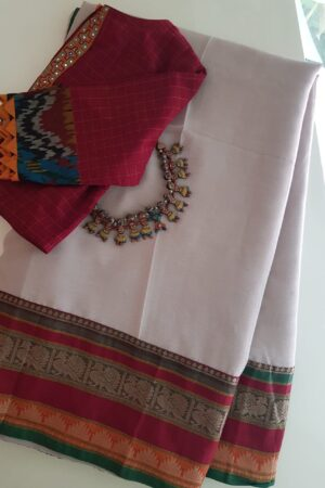Beige chiffon saree with red kanchi cotton border