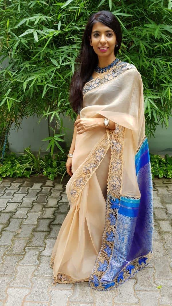 Beige organza cutwork saree with silk pallu