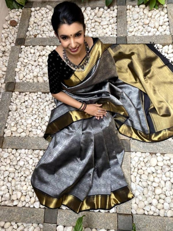 Black kanchipuram silk saree with silver body and gold border