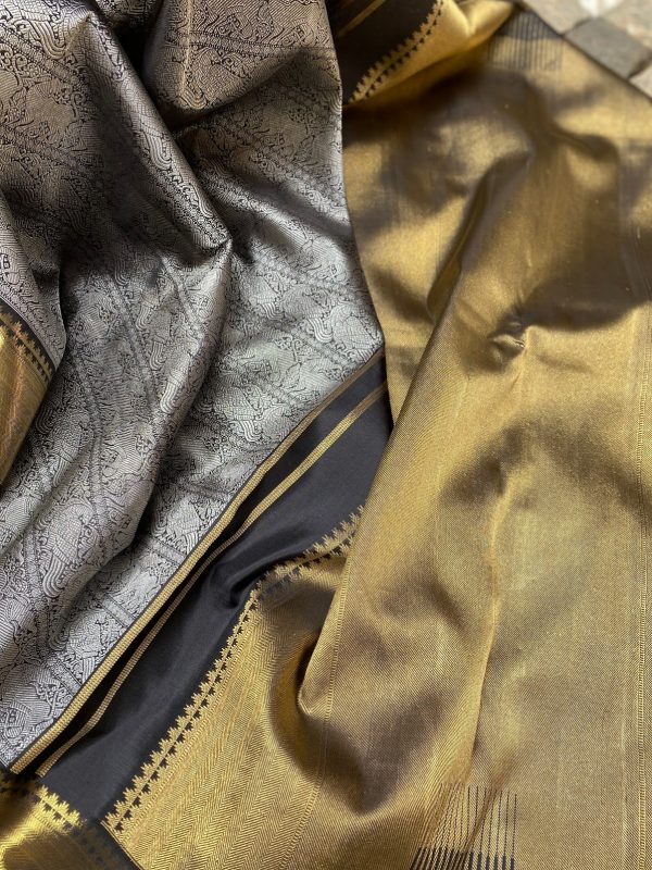 Black kanchipuram silk saree with silver body and gold border1