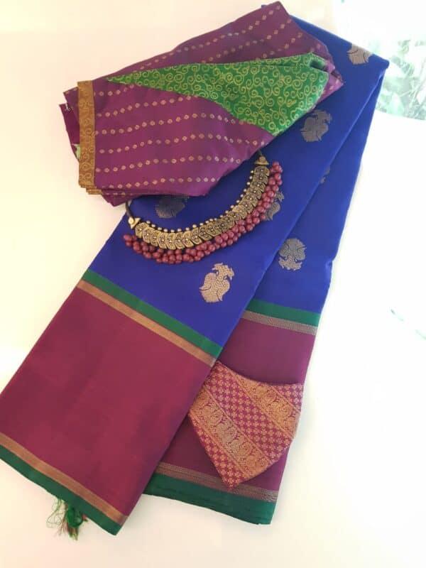 Blue kanchipuram silk saree with majenta border