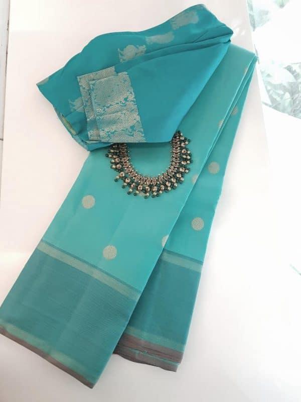 Blue kanchipuram silk saree with polka gots