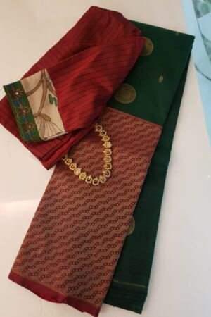 Bottle green and maroon one side border kanchipuram silk saree