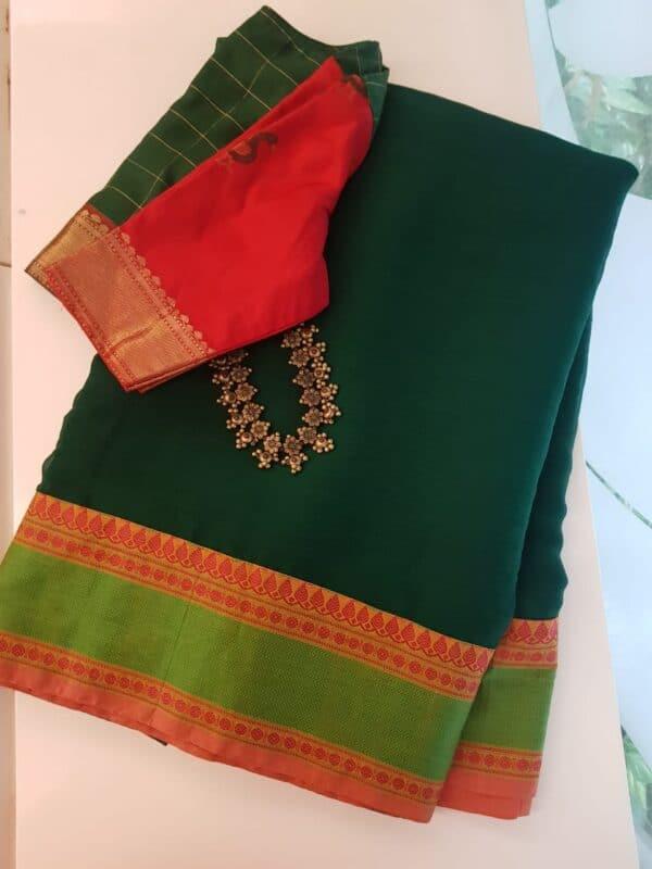 Bottle green chiffon saree with kanchi cotton border