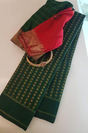 Bottle green kanchipuram silk saree with mayil chakram motifs