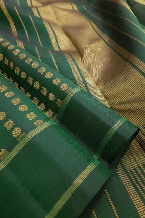 Bottle green kanchipuram silk saree with mayil chakram motifs1