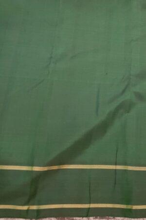 Bottle green kanchipuram silk saree with mayil chakram motifs2