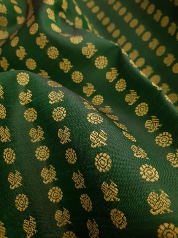 Bottle green kanchipuram silk saree with mayil chakram motifs3