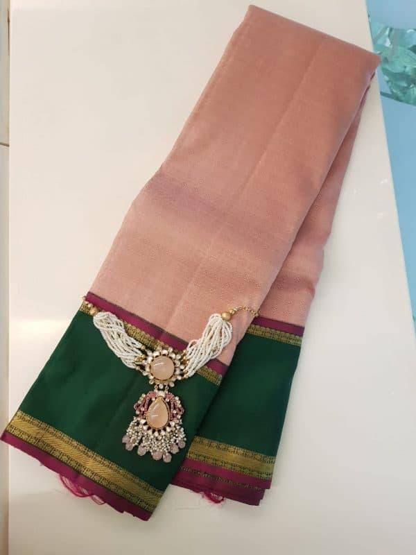 Dusty pink kanchipuram silk saree with green korvai border