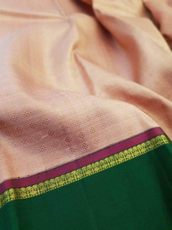 Dusty pink kanchipuram silk saree with green korvai border1
