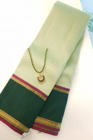 Green kanchipuram silk saree with korvai border