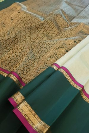 Green kanchipuram silk saree with korvai border1