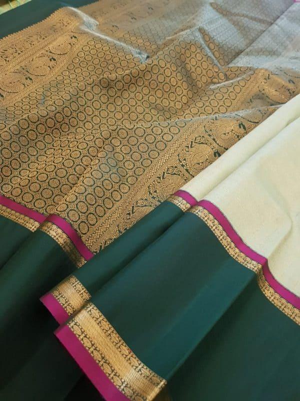 Green kanchipuram silk saree with korvai border1
