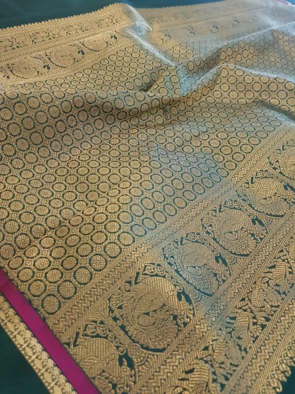 Green kanchipuram silk saree with korvai border4