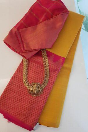 Mustard and pink one side border kanchipuram silk saree