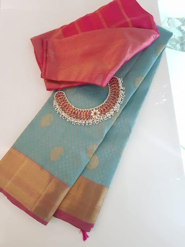 Pale blue kanchipuram silk saree with pink border