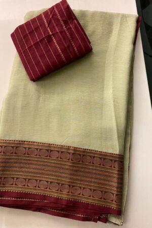 Pale greenish yellow chiffon saree with kanchi cotton border