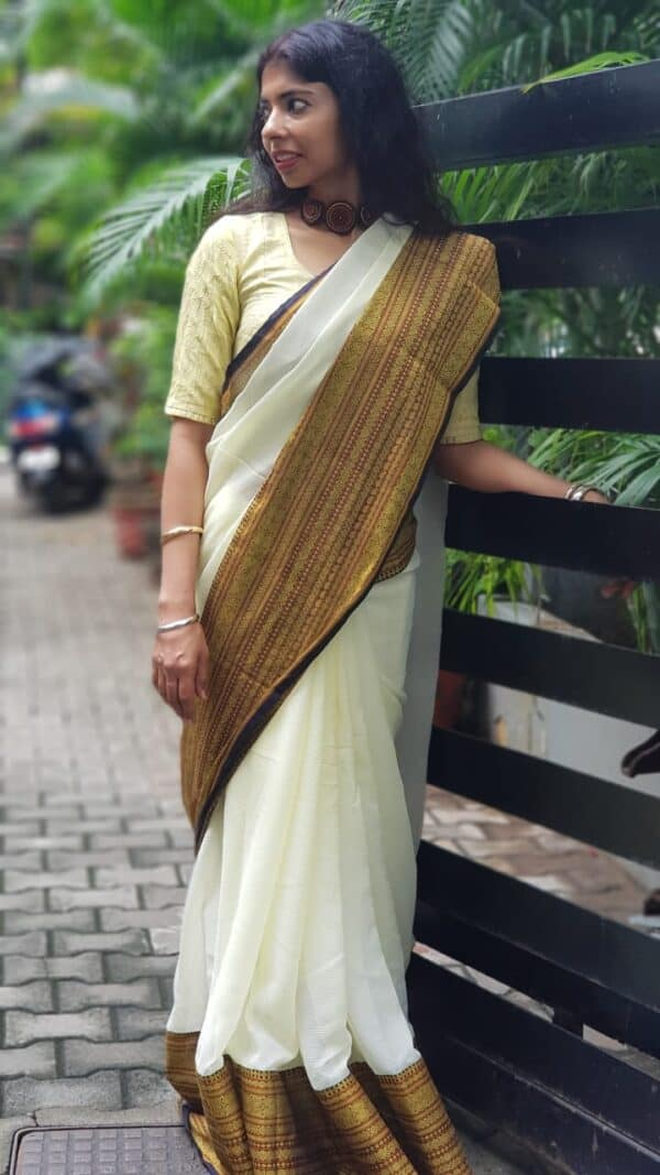 Butter yellow chiffon saree with kanchi cotton border
