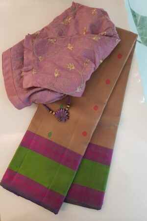 Beige soft silk saree with green border