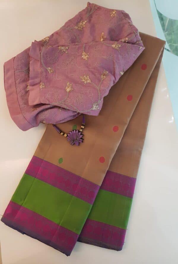 Beige soft silk saree with green border