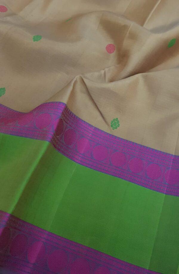 Beige soft silk saree with green border2