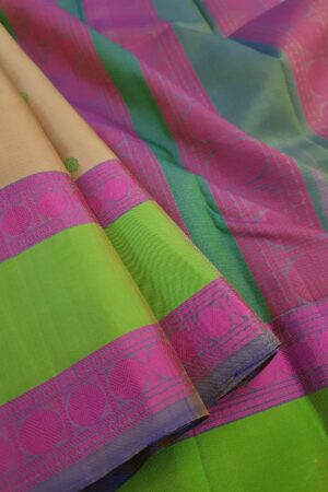 Beige soft silk saree with green border3