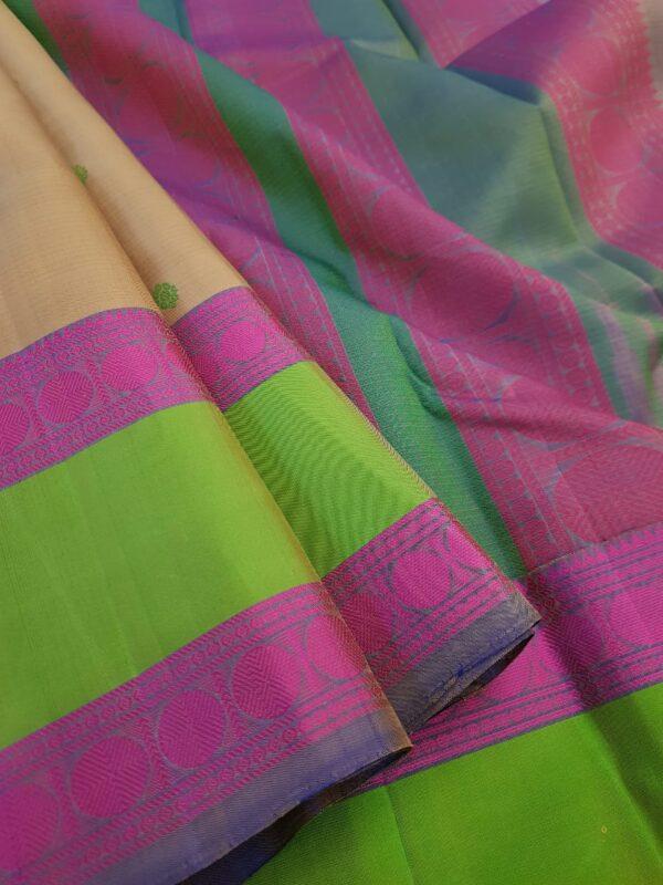 Beige soft silk saree with green border3