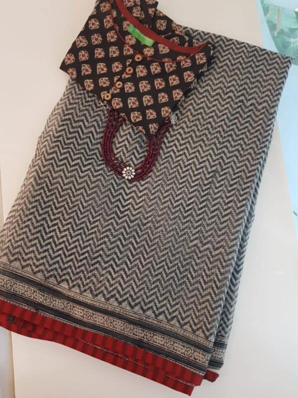 Beige with black zig zag and red cotton border
