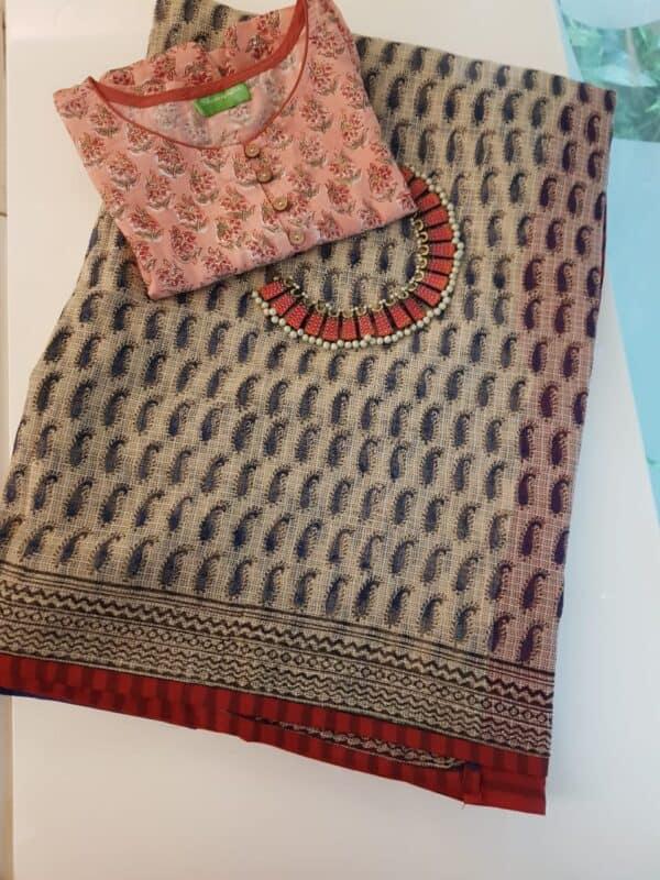 Beige with blue paisley printed kota saree