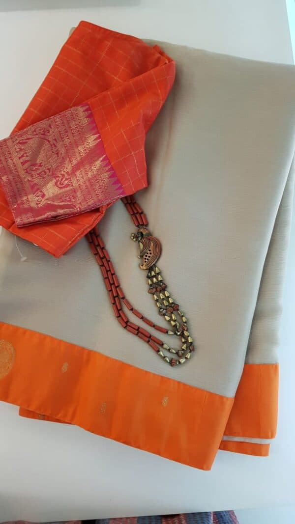 Beige with orange silk border