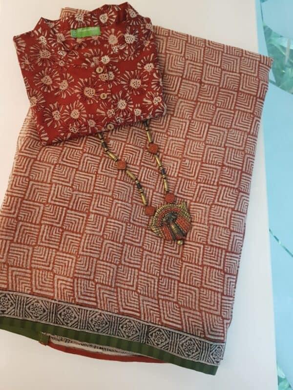 Beige with rust block printed kota saree with green border