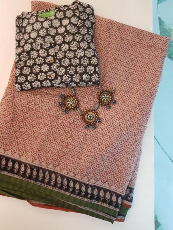 Beige with rust printed kota saree with green border